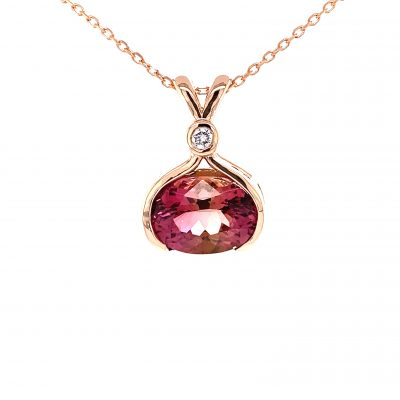 3.89 carat Pink Tourmaline ethically sourced from the Congo and magnificently cut in a faceted oval shape, set in a custom made 14k rose gold open bezel tied together with a brilliant .06 carat natural bezel set diamond G color and SI1 clarity. Chain is 18 inch rose gold cable chain with a lobster clasp. This is a one-of-a-kind pendant