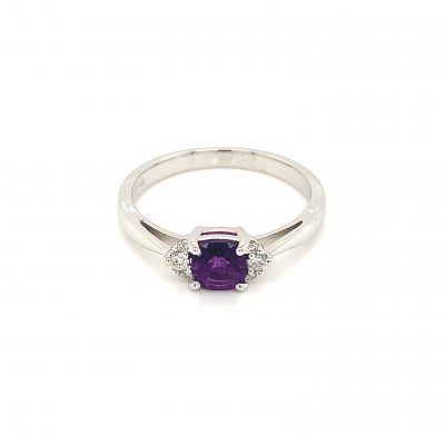 5mm Cushion Amethyst ring with 3 round accenting diamonds on each side of center framing the Amethyst, diamonds totaling .08ct GH SI2, 14k white gold