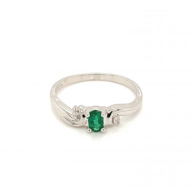 5x3 Oval Emerald ring with round accenting diamond on each side of center totaling .06ct GH SI2, 14k white gold
