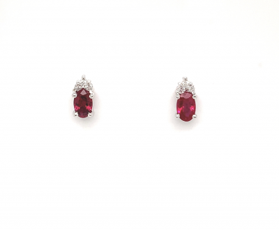 5x3mm oval Ruby post earrings with 3 round accenting diamonds set above, all diamonds totaling .06ct and all set in 14k white gold