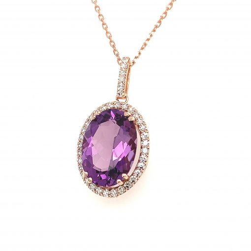 Oval Amethyst pendant, 14x10mm set into halo of 14k rose gold lined with diamonds, all diamonds single cut GH Color SI2 Clarity and totaling .45ct, peak-a-boo diamond on the bottom, 18 inch cable chain