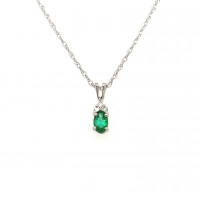 5x3mm Oval Emerald pendant with three round accenting diamonds totaling .025ct set above in all 14k white gold