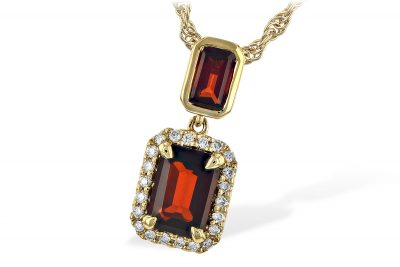 Double Emerald cut garnet pendant with bottom garnet surrounded by .11ct accenting round diamonds, both garnets totaling 1.45ct, 14k yellow gold, on 18 inch chain with lobster clasp