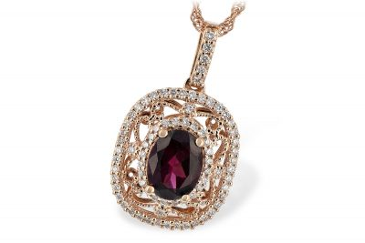 Vintage Rhodalite and Diamond Pendant with oval 1.10ct Rhodalite Garnet in the center of curls of 14k rose gold and halo of round accenting diamonds, diamonds all GH SI2 and totaling .31ct, 14k Rose gold 18 inch rope chain with lobster clasp