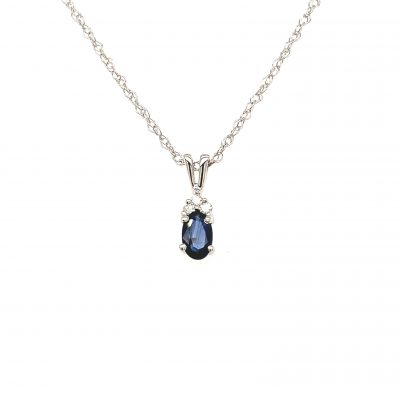 Oval sapphire pendant with three round accenting diamonds set above, diamonds totaling .025ct, all 14k white gold