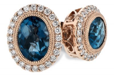 Earrings with Oval Checkerboard Cut London Blue Topaz framed with milgrain edging and surrounded by round accenting diamonds, diamonds GH SI2 totaling .25ct and blue topaz totaling 1.76ct, 14k rose gold