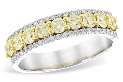 Yellow and White diamond band with .77ct round yellow diamonds set in 18k yellow gold through the center and round accenting G SI2 diamonds down each side of center row of yellow diamonds, white gold is 14k, white diamonds totaling .23ct