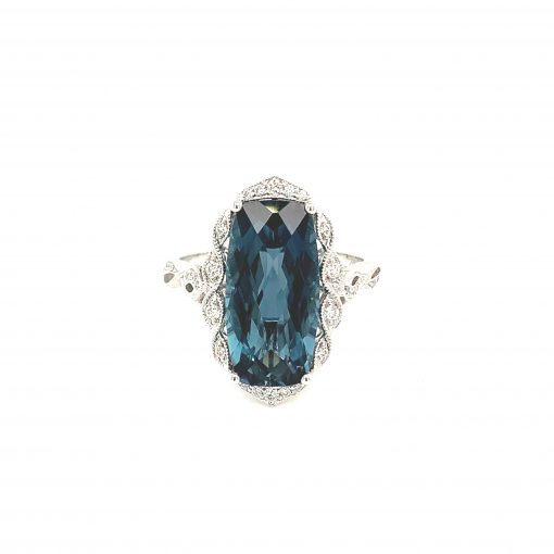 Rectangular Cushion Cut checkerboard London Blue Topaz vintage style ring with round accenting diamonds set into braided style halo surrounding blue topaz, diamonds totaling .15ct, GH SI2, 14k white gold