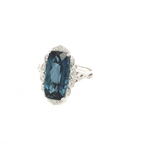 Rectangular Cushion Cut checkerboard London Blue Topaz vintage style ring with round accenting diamonds set into braided style halo surrounding blue topaz, diamonds totaling .15ct, GH SI2, 14k White Gold.