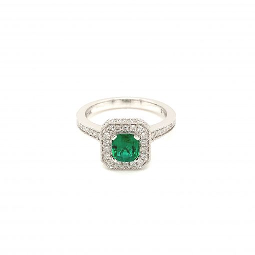Square shape ring with.65ct emerald in the center and .45ct round accenting diamonds surrounding the emerald and down the band, GH color, VS2/SI1 diamonds, 14k white gold