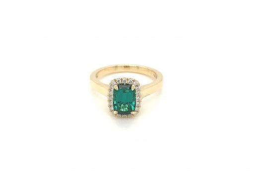 Rectangular 8.42x5.80x4.63mm 1.82ct Cushion cut green tourmaline surrounded by round accenting diamonds totaling .17ct GH Color SI2 Clairty, 14k yellow gold