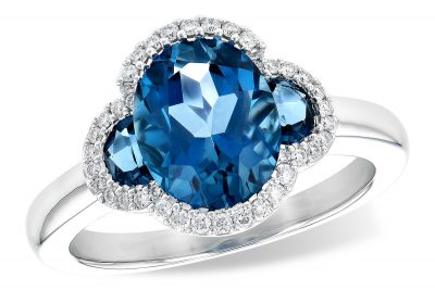 London blue topaz ring with 1 oval and 2 half moon london blue topaz all totaling 3.04ct and lined with round accenting diamonds totaling .16, 14k white gold, G SI1/SI2