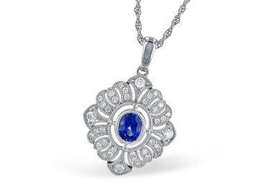 Vintage style pendant with .47ct oval sapphire set in the center of diamond shape lined with milgrain and diamonds, all diamonds totaling .25ct, G Color SI1 SI2 clarity, 18 inch light rope chain with lobster clasp, 14k white gold