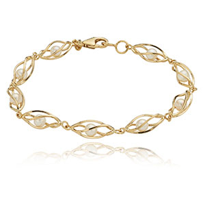 9 Genuine Akoya Cultured Pearls in a Swirl Cage 14K yellow gold Link Bracelet. Each Pearl is 4 millimeters round. The bracelet measures 7 inches in length.