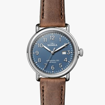The Runwell 41mm Shinola watch with Polished stainless steel case with double-domed sapphire crystal, Blue dial with Super-LumiNova hands British Tan quick-release strap hand sewn in the United States from premium leather